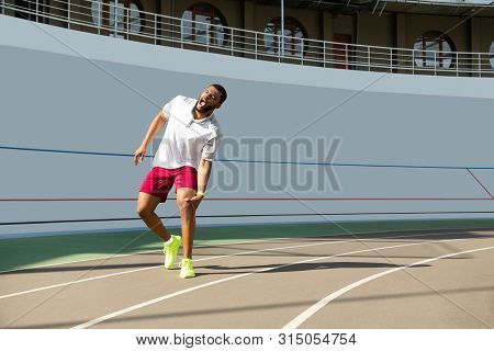 Muscular Young Male Runner Suffering From Kneecap Injury