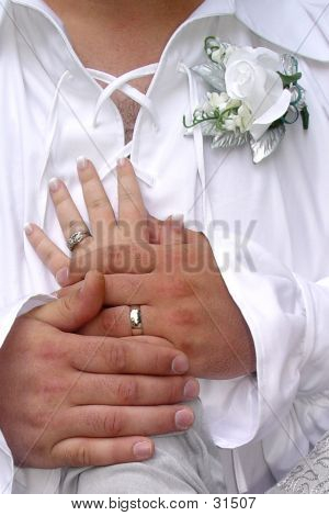 Hands Over Heart On Wedding Day