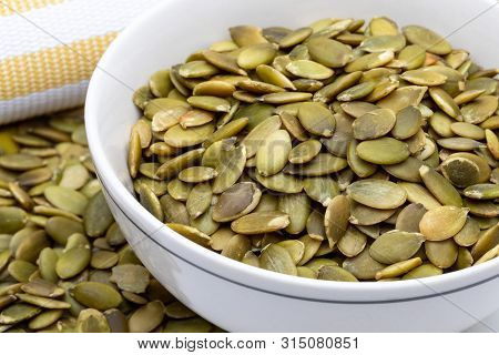 Pumpkin Seeds (peeled Seeds) (collection Of Various Nuts). Close-up. Isolated On White Background.
