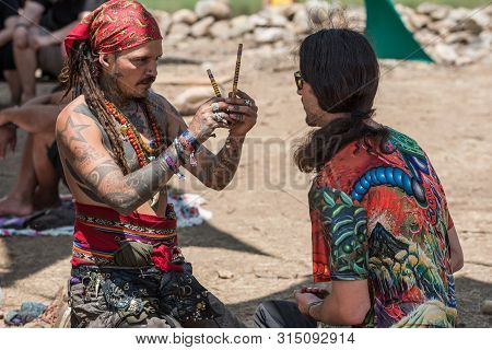 Riomalo De Abajo, Extremadura, Spain - July 15, 2018: Two Guys During A Rape Ceremony At The Lost Th