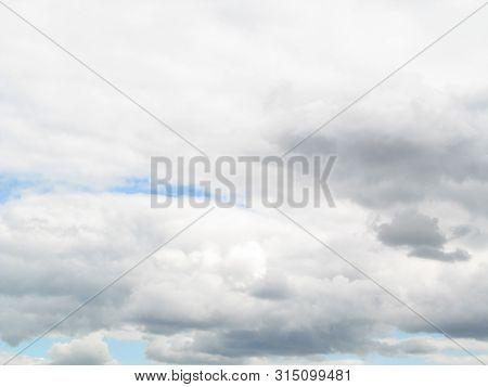 Some Cumulonimbus Clouds Are In The Sky. We See Rainy Clouds. The Cumulonimbus Clouds Are Vertical C