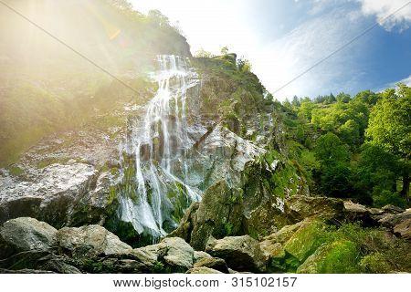 Majestic Water Cascade Of Powerscourt Waterfall, The Highest Waterfall In Ireland. Tourist Atraction