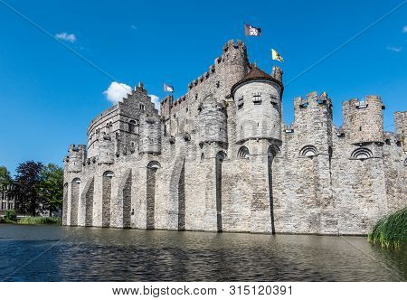Gent, Flanders, Belgium -  June 21, 2019: Gray Stone Castle And Ramparts Of Gravensteen, Historic Me