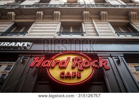Lyon, France - July 13, 2019: Hard Rock Cafe Logo On Their Restaurant In Lyon. Hard Rock Cafe Is A C