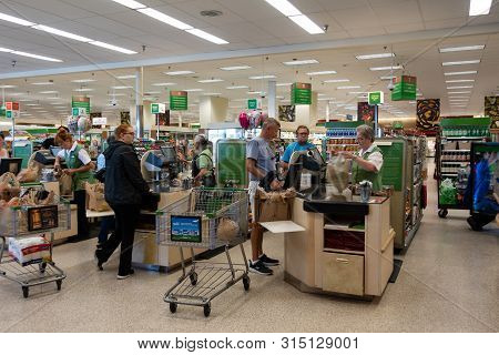 Vero Beach, Fl/usa - 8/2/19 - The Check Out Counter At The Grocery Store With Employees Checking Out