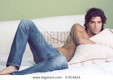 Sexy Man Lying In Bed Shirtless