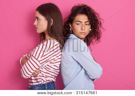 Profile Portrait Of Beautiful Girls With Dark Hair Frowning Her Face In Displeasure, Wearing Casual