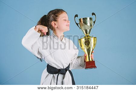 Celebrate Achievement. Strong And Confident Kid. Girl Little Child In White Kimono With Belt. Karate