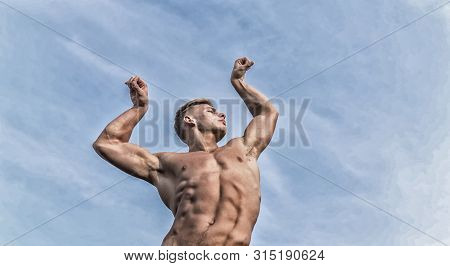 Man Muscular Athlete Bodybuilder Show Muscles. Bodybuilder Shape. Sexy Torso Attractive Body. Strong