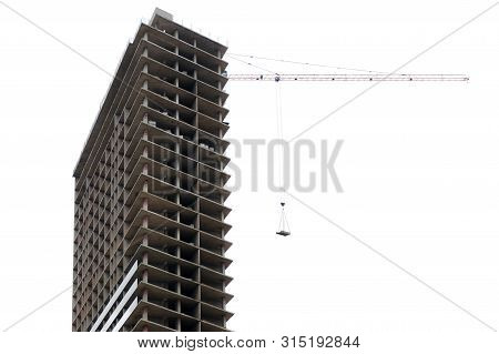 Skyscraper Under Construction With A Crane, Isolated On White Background. Building Of A Multistorey
