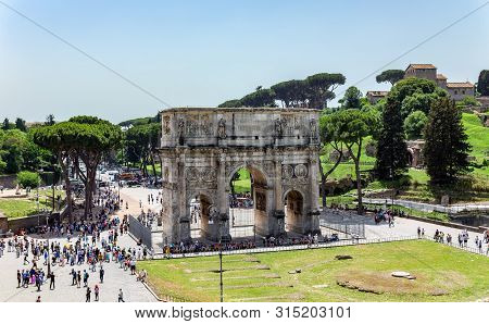 Triumphal Arch Of Constantine Near Colosseum. View From The Coliseum - Rome, Italy.