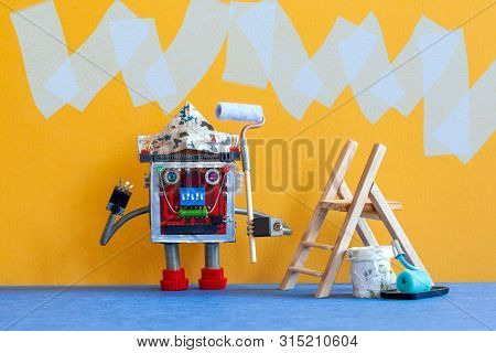 Painter Decorator Robot Ready For Interior Improvement. Funny Robotic Worker With Paint Rollers And