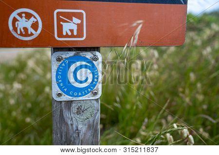Marin County, Ca May 27, 2019: California Coastal Trail Logo On Sign Posting Along Trailhead Path