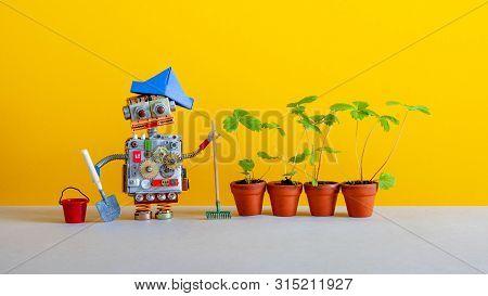 Modern Agriculture Robotic Gardening Technology. Robot Gardener Breeder With Bucket Shovel Rake And
