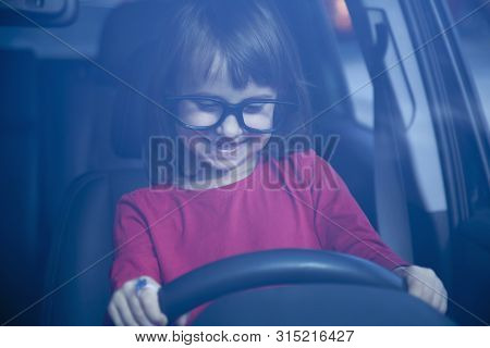 Driving Shool. Cute Little Child Girl Learns To Drive.