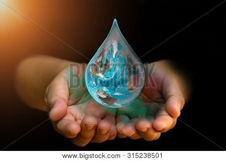 Blue Earth World With Dripping Water On Two Hand At Wait On Abstract Black Background. Water Shortag