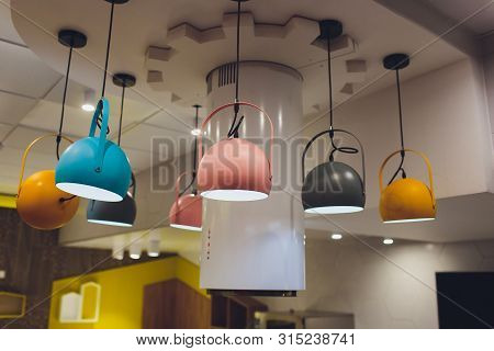 Modern Chandelier With Led Lamps Hanging On The Ceiling In The Interior Of The Room Inside The House