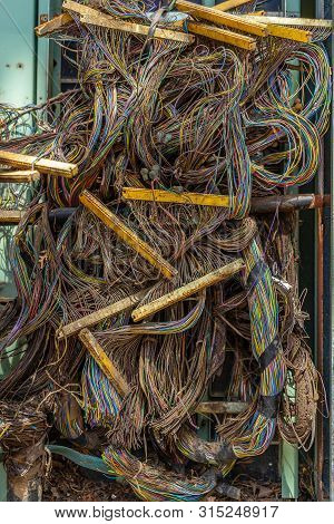 Bundles Of Multicolored Wires Intertwined With Each Other In The Rack Of The Data Center Server Room