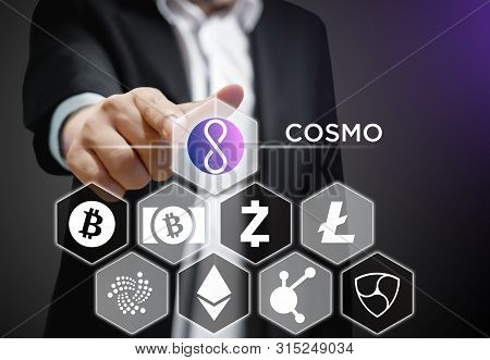 Concept Of A Business Man Pointing At Cosmo Coin, A Cryptocurrency Blockchain Platform , Digital Mon