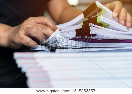 Business Documents Paperwork Overwork Concept : Employee People Hands Working In Stacks Paper Files