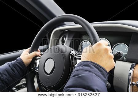 poster of Male hands holding car steering wheel. Hands on steering wheel of a car driving. Young Man driving a car inside cabin. Multimedia system. Man Traveling In Self Driving Car. Car inside. Driving concept