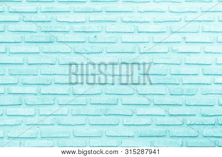 Brick wall painted with pale blue paint pastel calm tone texture background. Brickwork and stonework flooring interior rock old pattern clean concrete grid uneven bricks design stack. Brick wall of blue color. Blue brick wall background. Vintage, modern. poster