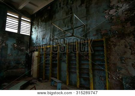 School gymnasium in the city of Pripyat in Ukraine. Emptiness. Dampness. Exclusion Zone. Nuclear danger. Ghost City Pripyat. Lost place. Ukraine. CCCP. Chernobyl zone. poster