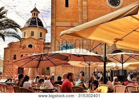 Altea, Alicante, Spain- September 19, 2018: People Having Drinks And Enjoying Nice Weather In Terrac
