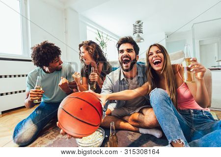 Happy Friends Or Basketball Fans Watching Basketball Game On Tv And Celebrating Victory At Home.frie
