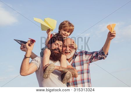 Family Generation: Future Dream And People Concept. Boy With Father And Grandfather. Father Son And