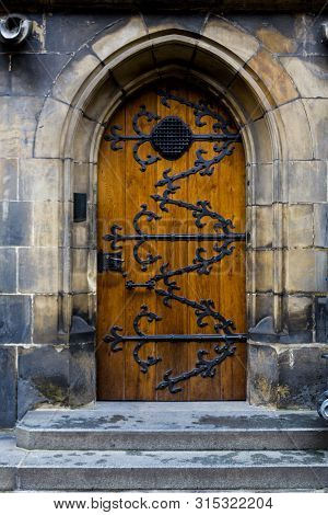 Old Wooden Door With Forged Pattern In Gothic Style. Prague Castle - Gothic Architecture Of St. Vitu
