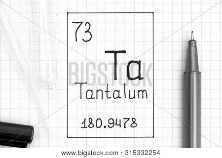 The Periodic Table Of Elements. Handwriting Chemical Element Tantalum Ta With Black Pen, Test Tube A