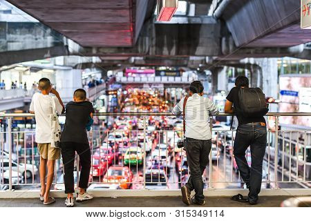 Bangkok, Thailand - Aug 31, 2018 : Group Of Thai People Looking At Heavy Traffic Jam In Front Of Sia