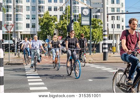 People Riding Bikes In The City Center, Sunny Spring Morning