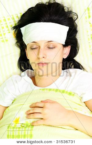 Young Woman With Eyes Closed Being Ill In Bed
