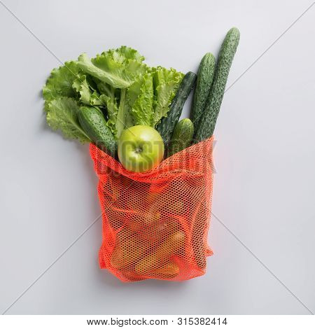 Modern Shopping Mesh Bag With Fresh Green Vegetables. View From Above. Zero Waste Concept.