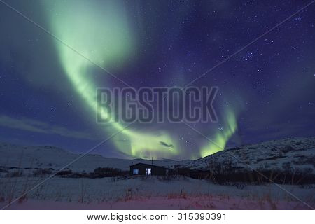 Northern Lights Or Aurora Borealis. Kola Peninsula Winter Landscape
