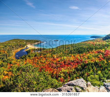 Panoramic View Of The Stunning Fall Colors And Blue Waters Of The Bay In Acadia National Park