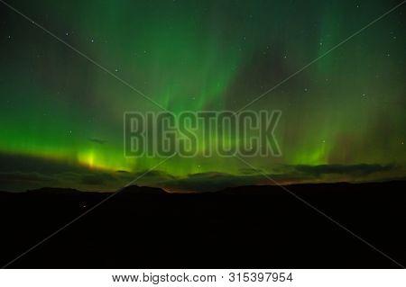 Northern Lights Above Reykjavik, Iceland. Polar Lights Or Northern Wand In Reykjavik, Iceland. Beaut