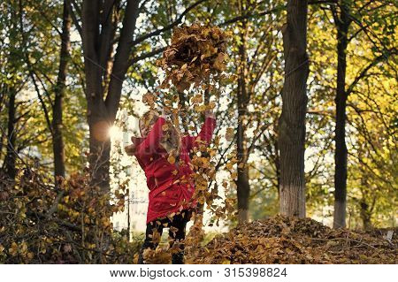 Fall Clothes And Fashion Concept. Child Blonde Long Hair Walking Fall Park Background. Girl Happy We