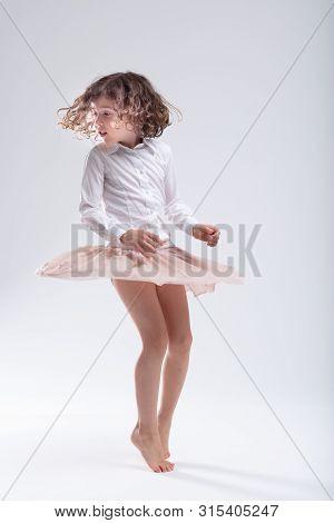 Cute Little Barefoot Girl Doing A Pirouette