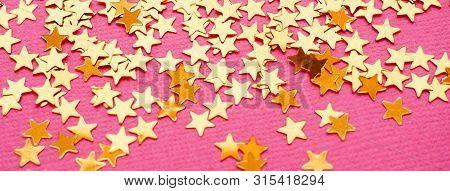 Golden Stars Glitter On Pink Background. Festive Holiday Bright Backdrop