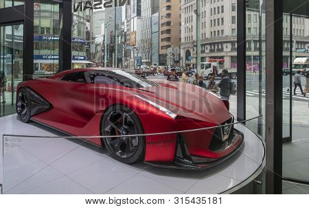 Tokyo, Japan - Mar 26, 2019: People Looking At A Nissan Concept 2020 Vision Gran Turismo Car In A Sh