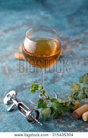 White Wine In A Glass. The Concept Of Winemaking. Place Under Your Text. Still Life On A Textural Ba