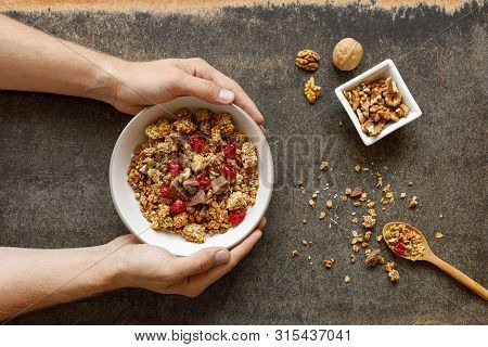 Bowl Of Granola With Dried Berries, Walnuts And Chocolate.
