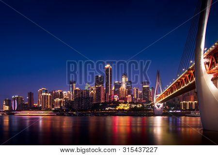 Chongqing, China - July 24, 2019: Panoramic View Of Chongqing Skyline And Chaotianmen Bridge Over Ya