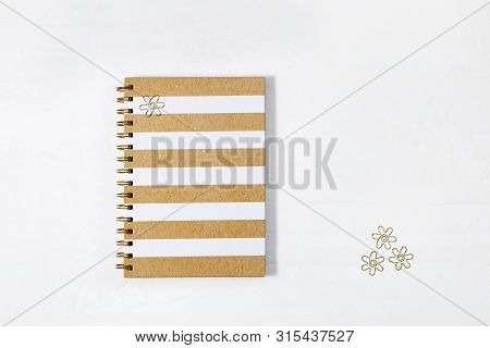 School Closed Notebook On Spring With Bright Lined On Cover And Gold Metal Clips On White Desk. Back