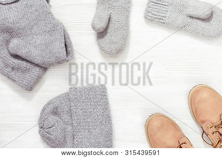 Autumn Or Winter Female Outfit. Set Of Clothes And Shoes On White Background. Warm Knitted Cap, Mitt