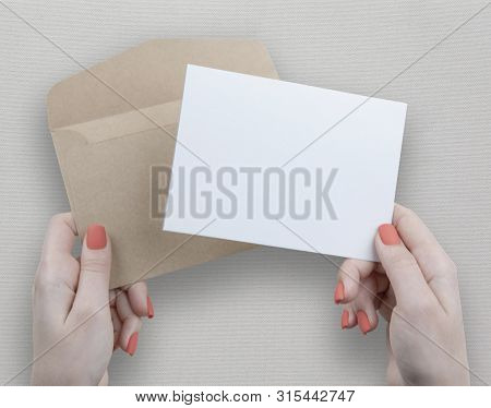 A Woman Holding A White Business Card