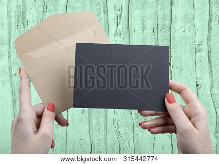 A Woman Holding A Black Business Card